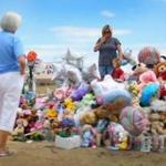 Residents assembled a memorial for victims across the street from the movie theater where the shootings took place.