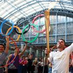 Torch-bearer Daniel Mccubbin helped move the Olympic flame in London on Thursday.
