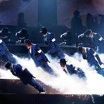"""Michael Jackson: The Immortal World Tour by Cirque du Soleil"" employs an arsenal of mimes, acrobats, and dancers — as well as a live band — to showcase Jackson's songs."