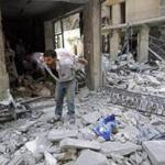 A man carried belongings from his shop destroyed by shelling in Aleppo.