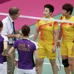 An official spoke with players from China and South Korea before the teams were disqualified from the badminton doubles competition.