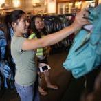 Joanne Ly, a Curry College student, and her sister Amy Ly, 11, searched for backpacks at L.L. Bean in Dedham.