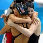 Dana Vollmer (left), Missy Franklin (right) and Rebecca Soni embraced after a world record gold medal win in the women's 4x100m medley relay final.