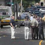 Boston police were at the crime scene near a bus stop on Warren Street on Wednesday. A stabbing victim died later at a hospital, according to authorities. The assailant was still being sought.