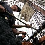Chief Petty Officer Select Tracy Walker helped hoist a sail aboard in preparation for Sunday's commemoration.