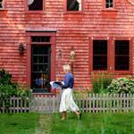 Hostess Heidi Humphries, top, walks past the Russos' 1729 farmhouse.
