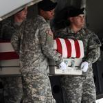 Soldiers carried a flag-draped transfer case containing the remains of US Army Major Thomas E. Kennedy of West Point, N.Y., at Dover Air Force Base on Aug. 10.