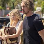 "Annie (Kristen Bell) and Charlie (Dax Shepard) rolling in ""Hit & Run."""