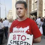 "A picket in front of Parliament carried a poster reading ""WTO is Death for Russia"" in Moscow Tuesday."