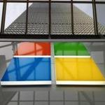 Microsoft unveiled a new corporate logo at the store opening in the Prudential Center Thursday.