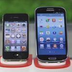Apple's suit contends Samsung's Galaxy phone (right) copies iPhone technology.