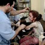 Syrian children received treatment Friday after shells from government forces hit their house in Aleppo.