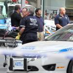 Officials removed the body of a man who opened fire outside the Empire State Building on Friday. New York police said a laid-off clothing designer killed an executive from his former company as pedestrians heading to work packed the street.