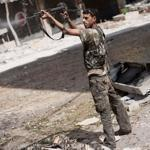 A rebel in the Free Syrian Army fired against regime positions in the Salaheddine district of Aleppo on Friday.