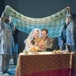 "The wedding of Soraya (Paige Clark) and Amir (Nael Nacer) in New Repertory Theatre's ""The Kite Runner.''"