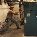 Pipe fitter Jerry Williams worked on new gas boilers being installed by Ameresco Inc. for the Boston Housing Authority.