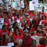 Striking teachers and their backers marched Monday. Negotiators left the table hours later to consider new proposals.