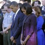 President Barack Obama, first lady Michelle Obama, and members of the White House staff paused during a moment of silence to mark the 11th anniversary of the Sept., 11, 2001, attacks.