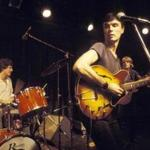 David Byrne (center) and the Talking Heads perform in New York in 1977.