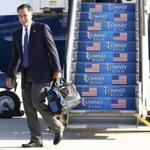 Mitt Romney stepped off his campaign plane in Sterling, Va., Wednesday.