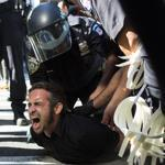 Occupy Wall Street protester Chris Philips screamed as he was arrested near Zuccotti Park in New York City on Monday.