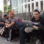 Customers lined up outside the Apple store on Fifth Avenue in New York City Monday to await the arrival of the iPhone 5.