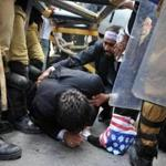 A Pakistani lawyer was helped under a barrier Wednesday as police stopped him on way to the US Embassy in Islamabad.