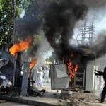 Pakistani demonstrators vandalised machinery during a protest against an anti-Islam film in Peshawar on Friday.