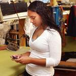 Jayme Rose sends a text message in her mother's Hyannis shop.