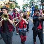 The Second Line Social Aid & Pleasure Society Brass Band (featuring trombone players, from left, Jesse Metzler, Kate Riegle-Van West, and Kevin Leppmann) came up with the idea for the HONK! Festival.