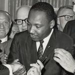 President Lyndon B. Johnson shakes hands with Martin Luther King Jr. at the signing of the Civil Rights Act of 1964,