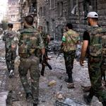 Government forces patrolled in Aleppo. Activists said 48 civilians and 22 regime soldiers died in fierce fighting Monday.