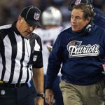 Patriots coach Bill Belichick doesn't appear to buy what head linesman Rodney Russell is telling him Sunday night.