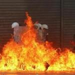 A group of riot policemen were surrounded by flames after protesters threw gasoline bombs in Athens.
