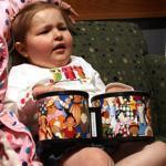 Avalanna Routh (right) played the bongos as part of a music therapy session at the Dana-Farber and the Jimmy Fund Clinic  in 2011.