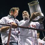 Two high-profile members of the 2004 champions — Kevin Millar and Pedro Martinez — were in the spotlight again, with a piece of shining hardware.