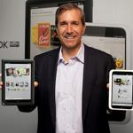 William Lynch, chief executive of Barnes & Noble, showed the new Nook HD+ (left) and the Nook HD.