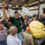 Ron Wallace exulted after his pumpkin weighed in at 2,009 pounds Friday at the Topsfield Fair.