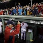 Bobby Valentine gestured to fans after the team's last game of the season at Fenway Park on Wednesday.