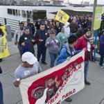 Hundreds of people turned out to march in East Boston Sunday night to support 14,000 unionized New England janitors.