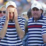 Americans (left to right) Jim Furyk, Phil Mickelson, and Webb Simpson appear shell-shocked after the Europeans rallied in remarkable fashion to capture the 39th Ryder Cup.