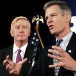 Senator Scott Brown spoke with reporters at an appearance with former Massachusetts Governor William Weld in Boston on Friday.
