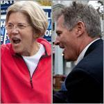 Senator Scott Brown and Democratic challenger Elizabeth Warren marched through East Boston on Sunday as part of the city's annual Columbus Day parade, held in advance of the Monday holiday.