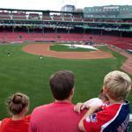 Gary Levin and his children Cassie (left) and Jason viewed Fenway from atop the Green Monster.