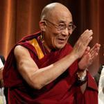 The Dalai Lama waved to the audience Sunday after his talk. Joining him were the Rev. Liz Walker, the moderator, and Brother David Steindl-Rast, one of two Catholic priest panelists.