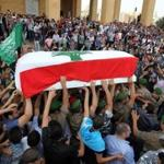 The coffin of Brigadier General Wissam al-Hassan, who was assassinated Friday by a car bomb, was carried during a funeral procession in Beirut.