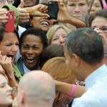 President Barack Obama shook hands with supporters during a campaign rally at the George Mason University in Fairfax, Virginia.