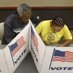 A couple voted Wednesday in Iowa, where early ballots are likely to set a state record as campaigns try to lock in votes.