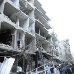 Despite a holiday cease-fire, a car bomb damaged this building Friday in Damascus, Syria.