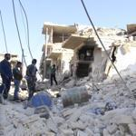 Rebel fighters and residents inspected a destroyed building in the northern city of Maaret al-Numan on Tuesday.